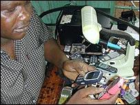 A man repairing mobile handsets