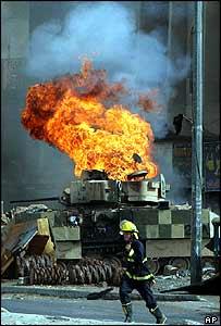 US tank burns in Baghdad, 13 August