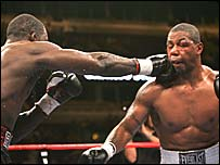 Hasim Rahman lands a blow on Monte Barrett's chin