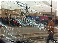 Bullet riddled windscreen of governor's bodyguards car