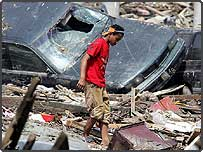 A boy searches among the debris in Banda Aceh, Indonesia (AFP/Getty Images)