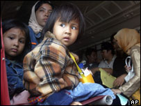 Children-survivors board a C-130 transport plane at military-controlled airport in Banda Aceh, 1 Jan 2005