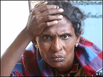 A Tamil woman grieves over lost relatives in last weekend's massive tsunamis in a makeshift refugee camp, Sunday, Jan. 2, 2005,