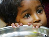 Young Indian girl waits for food.