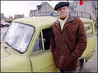 Del Boy, played by David Jason, with his Robin Reliant