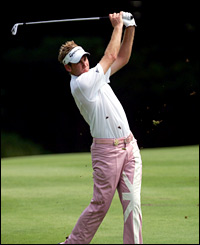 Ian Poulter plays an iron