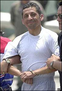 Maj Humala is escorted by police after arriving at the airport in Lima on 4 January 2005