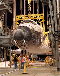 The US space shuttle Discovery receives post-flight servicing in the Mate-Demate Device (MDD) on 9 August 2005 at Nasa's Dryden Flight Research Center, Edwards Air Force Base in California