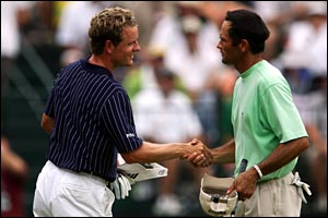 Luke Donald (L) shakes hands with partner Steve Schneiter