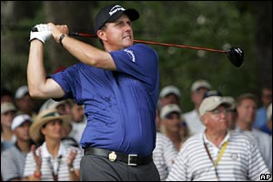 Phil Mickelson drives up the first