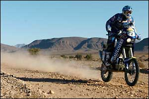 France's Cyril Despres rides through the desert during the fifth stage between Agadir and Smara