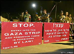 Police stand by the barrier at the Kissufim crossing from Israel into Gaza