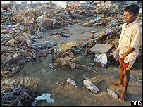 Young Indian tsunami victim looks at debris and ruined houses in Nagattipatinam