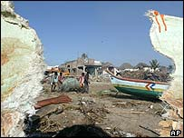Fishing boats damaged by tsunami in India