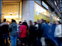 Christmas sales shoppers at Next store on London's Oxford Street