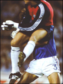 German goalkeeper Harald Schumacher launches himself at France's Patrick Battiston in the 1982 World Cup semi-final