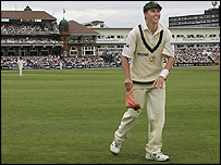 Brett Lee picks up a fake severed foot thrown from the Old Trafford crowd