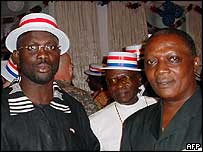 Presidential candidates George Weah (l) and Roland Massaquoi (r)