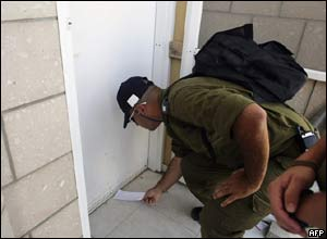 Solider delivers an eviction letter