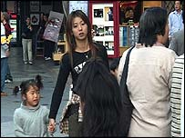 Young woman with child in Japan