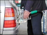 Photo of man filling car with fuel