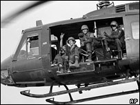 US troops in a helicopter in Vietnam
