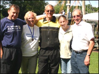 Thames swimmer Andy Nation (centre) with his team