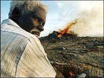 Tsunami debris burns on the beaches of southern India