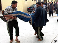 An injured man is carried away after the blast in Ramadi
