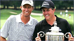 Phil Mickelson and caddie James McKay