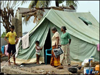 Displaced family living in tent, AFP