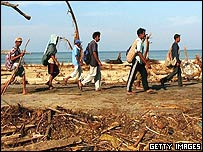 People from a destroyed village make their way to the city of Banda Aceh from Aceh province January 6, 2005 Indonesia.