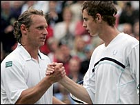David Nalbandian commiserates with Andy Murray