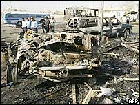 Wreckage of vehicles at Baghdad's Nahda bus station