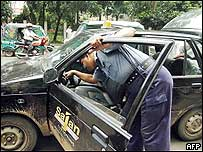 Bangladeshi security officials search a taxi following the blasts