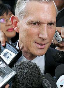 Netherlands' Foreign Minister Bernard Bot is mobbed by reporters, Aug. 17, 2005.