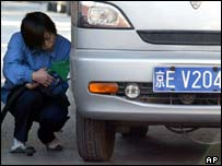 Chinese driver filling up car