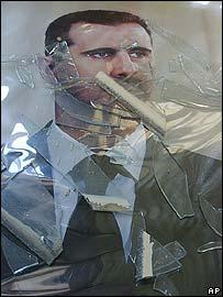 Shattered portrait of Bashar Al-Assad