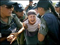 Gaza settler being taken away from Neve Dekalim