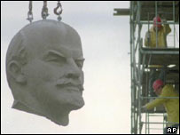 Statue of Lenin being removed, AP