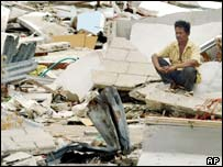 A man surveys damage to his property in Phuket, Thailand