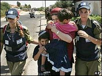 Settlers being taken away from Neve Dekalim