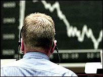 A trader watches share price movements