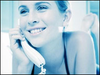 A smiling woman on the telephone