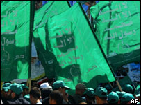Palestinian supporters of the Islamic Hamas movement carry Hamas flags in Gaza City