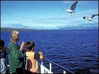 Ferry passengers feeding seagulls