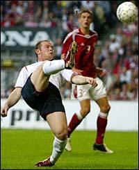 Wayne Rooney has a shot on goal