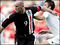 Wales skipper John Hartson battles with Slovenia's Bostjan Cesar