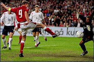 Jon Dahl Tomasson fires home Denmark's second goal
