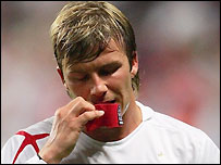 England captain David Beckham stands dejected after their 4-1 defeat